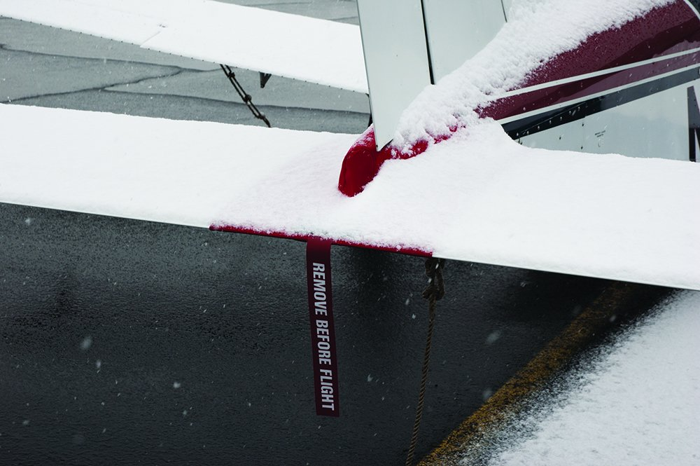 snowy aircraft tail